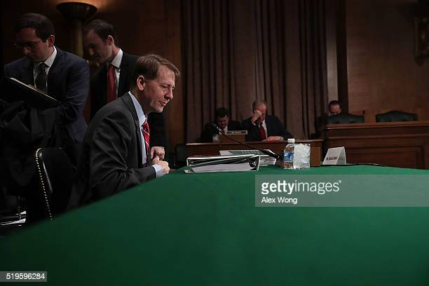 Director of the Consumer Financial Protection Bureau Richard Cordray waits for the beginning of a hearing before the Senate Banking Housing and Urban...
