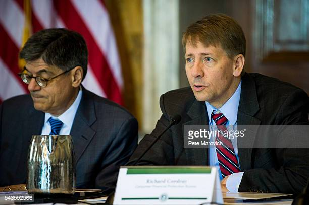 Director of the Consumer Financial Protection Bureau Richard Cordray delivers remarks during a public meeting of the Financial Literacy and Education...