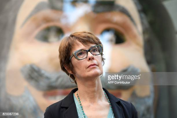 Director of the Dali Museum Montserrat Aguer listens during a press conference outside the TeatreMuseu Dali following the exhumation of Salvador...