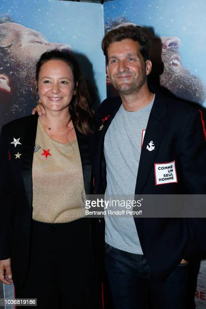 Director of the Documentary Navigator Eric Bellion and his wife Marie attend the Comme un seul Homme As a lonely Man Documentary Film Premiere at...