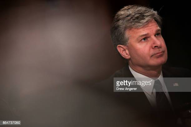 Director of the Federal Bureau of Investigation Christopher Wray listens testifies during a Senate Committee on Homeland Security and Governmental...