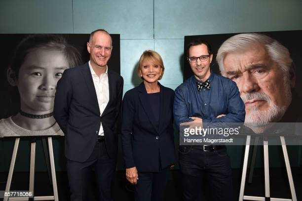 Director of the Le Meridien Munich Frank Beiler actress Uschi Glas and photographer Dirk Schiff during the 'We are all the same' Exhibition Opening...