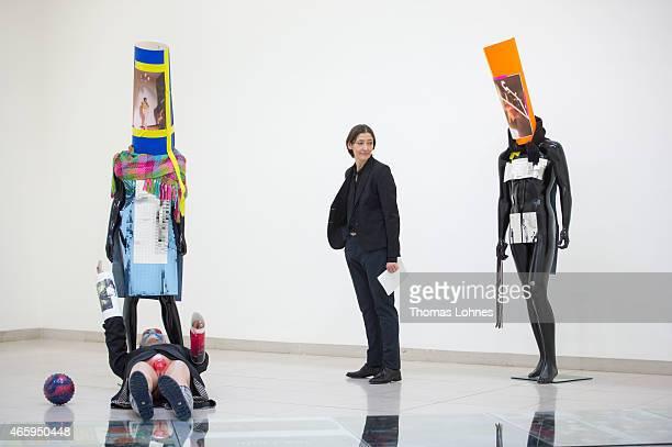 Director of the MMK Susanne Gaensheimer looks to the installation 'Schauspieler II 1112' by the artist Isa Genzken at Museum fuer Moderne Kunst on...
