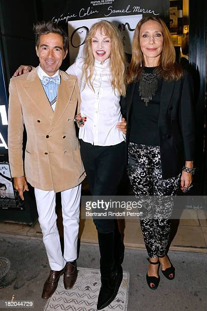 Director of the movie Arielle Dombasle between actors of the movie Vincent Darre and Marisa Berenson attend 'Opium' movie Premiere held at Cinema...