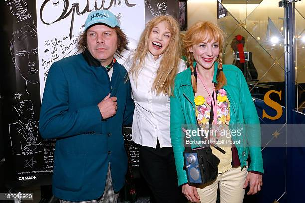 Director of the movie Arielle Dombasle between actors of the movie Julie Depardieu and companion Philippe Katerine attend 'Opium' movie Premiere held...