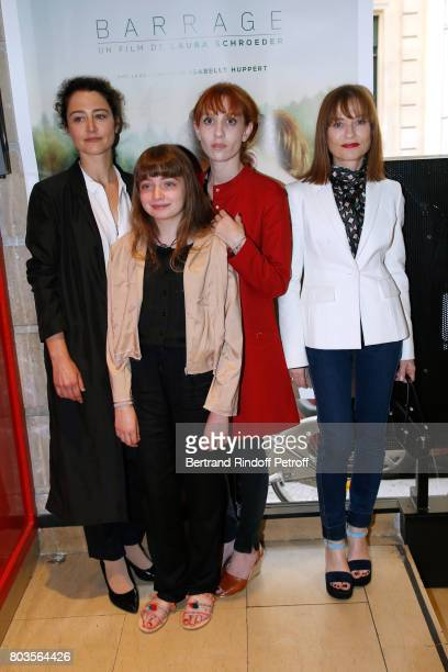 Director of the movie Laura Schroeder actresses of the movie Themis Pauwels Lolita Chammah and her mother Isabelle Huppert attend the 'Barrage' Paris...