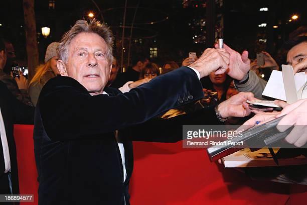 Director of the Movie Roman Polanski signs autographs whyle arriving at 'La Venus a La Fourrure Venus in Fur' Premiere at Cinema Gaumont Marignan on...