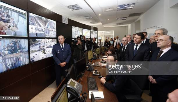 Director of the municipal police of Nice JeanMichel Truglio looks on as French Interior Minister Bernard Cazeneuve AlpesMaritimes Prefect Adolphe...