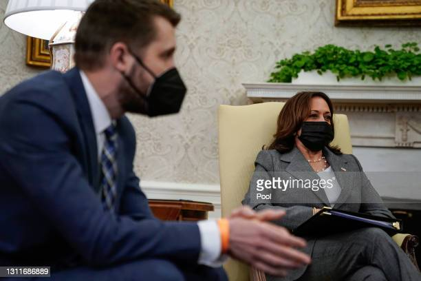 Director of the National Economic Council Brian Deese and Vice President Kamala Harris listen during the weekly economic briefing in the Oval Office...