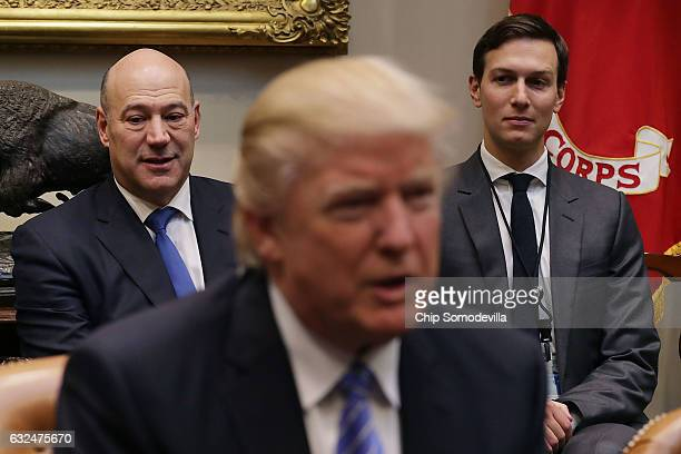 Director of the National Economic Council Gary Cohn and Senior Advisor Jared Kushner listen to US President Donald Trump deliver opening remarks...