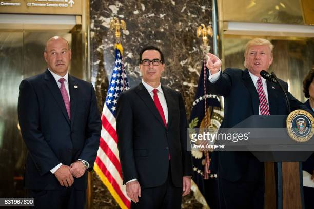 Director of the National Economic Council Gary Cohn and Treasury Secretary Steve Mnuchin look on as US President Donald Trump delivers remarks...