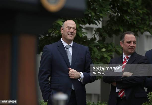 Director of the National Economic Council Gary Cohn and White House Chief of Staff Reince Priebus listen druing an event at the Kennedy Garden of the...