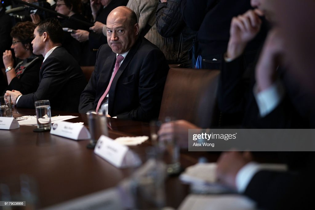 Director of the National Economic Council Gary Cohn (C) listens during a meeting between President Donald Trump and congressional members in the Cabinet Room of the White House February 13, 2018 in Washington, DC. President Trump held a meeting with congressional members to discuss trade.
