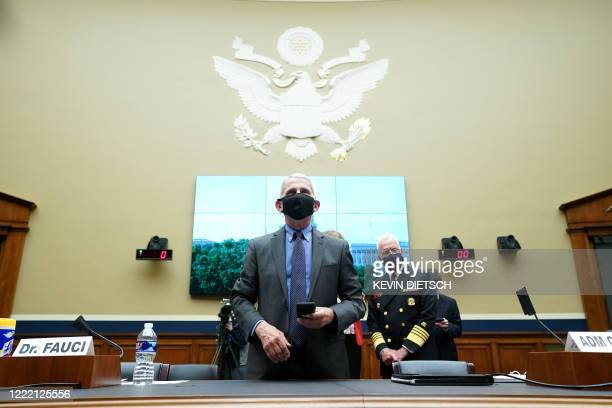 Director of the National Institute for Allergy and Infectious Diseases Dr. Anthony Fauci arrives to testify before the US Senate Health, Education,...