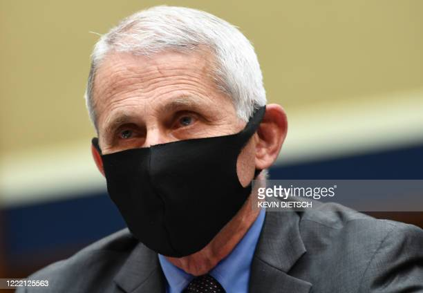 Director of the National Institute for Allergy and Infectious Diseases Dr. Anthony Fauci waits to testify before the US Senate Health, Education,...