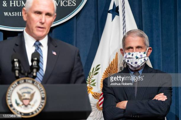 Director of the National Institute of Allergy and Infectious Diseases Anthony Fauci watches as Vice President Mike Pence speaks after leading a White...