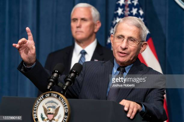 Director of the National Institute of Allergy and Infectious Diseases Anthony Fauci speaks as U.S. Vice President Mike Pence listens after a White...