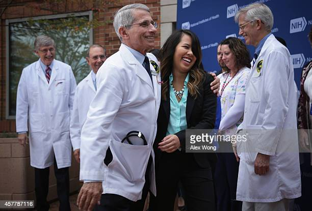 Director of the National Institute of Allergy and Infectious Diseases Anthony Fauci leaves with Nina Pham the nurse who was infected with Ebola from...