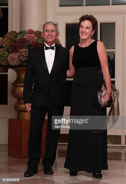 Director of the National Institute of Allergy & Infectious Diseases at the National Institute of Health Anthony Fauci and his wife Christine Grady...