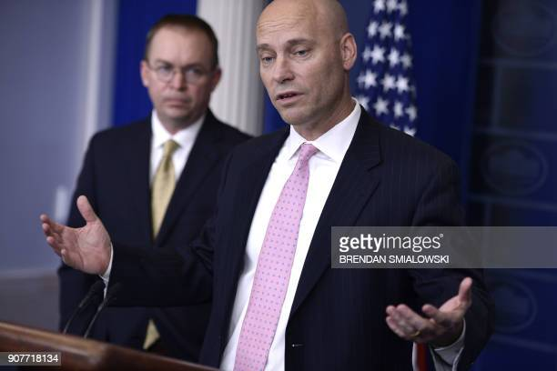 Director of the Office of Management and Budget Mick Mulvaney listens while Director of Legislative Affairs Marc Short speaks during a briefing at...