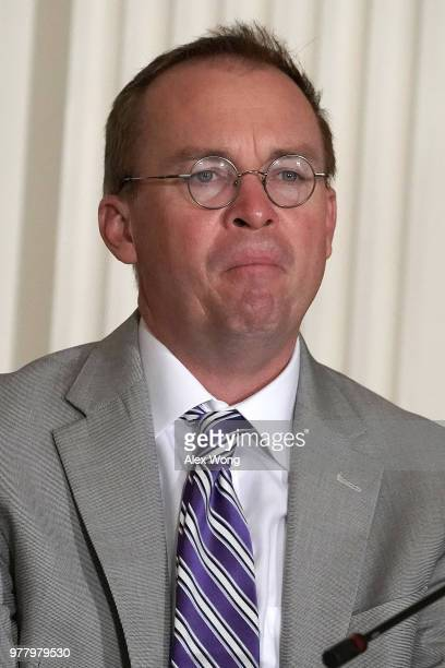 Director of the Office of Management and Budget Mick Mulvaney listens during a meeting of the National Space Council at the East Room of the White...