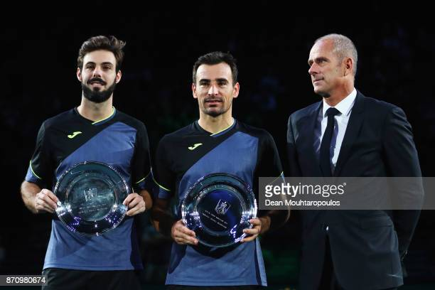 Director of the Paris Masters Guy Forget is pictured with Mens Doubles Final runnersup Marcel Granollers of Spain and Ivan Dodig of Croatia during...