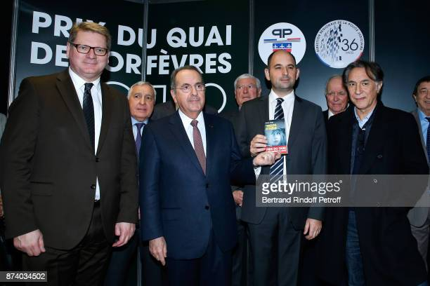 Director of the 'Police Judiciaire' Christian Sainte Paris Police Prefect Michel Delpuech writer Sylvain Forge and Sponsor of the 2018 Prize Richard...