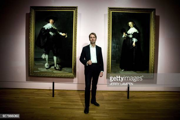 Director of the Rijksmuseum Amsterdam Taco Dibbits poses in front of Rembrandt's 1634 paintings 'Portrait of Maerten Soolmans' and 'Portrait of...