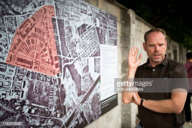 Director of the Sachsenhausen memorial and museum Axel Drecoll gives a guided tour of the former concentration camp in Oranienburg eastern Germany on...