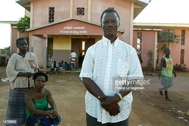 Director of the Saint Camille psychiatric hospital, Gregoire Ahongbonon poses in the courtyard of his hospital October 16, 2002 in Bouake, Ivory...