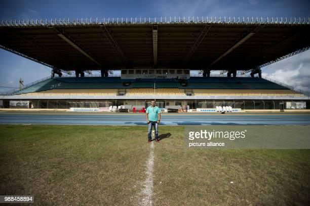 Director of the Zerao soccer stadium Irismar Mazinho Veras stands on the centre line of his stadium in Macapa Brazil 17 November 2017 Measurements...