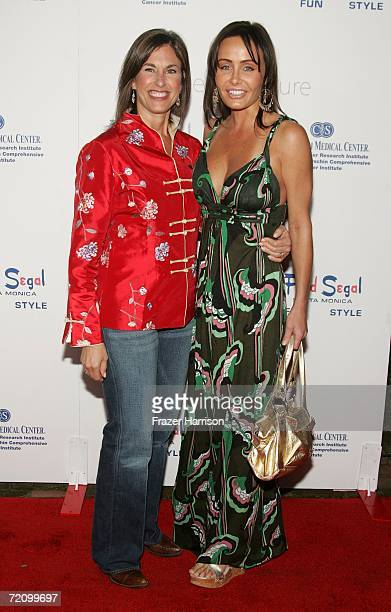 "Director of Women's Cancer Institute Dr. Beth Karlan and actress Kelli McCarty arrive at the inaugural ""Design A Cure"" charity event benefiting..."