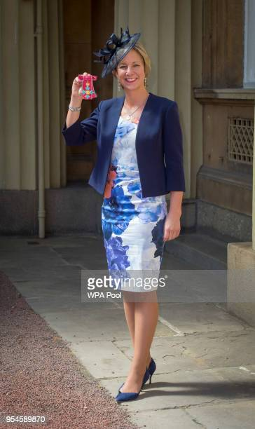 Director of Women's Cricket Clare Connor poses following an Investiture ceremony where she was awarded The Most Excellent Order of the British Empire...