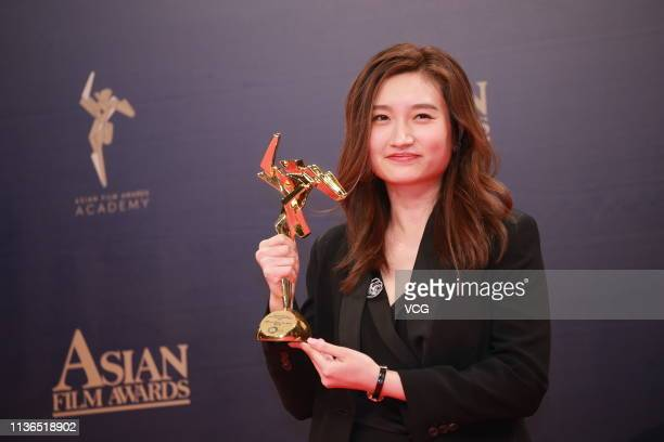 Director Oliver Siu Kuen Chan poses with the trophy backstage after winning the Best New Director during the 13th Asian Film Awards on March 17 2019...
