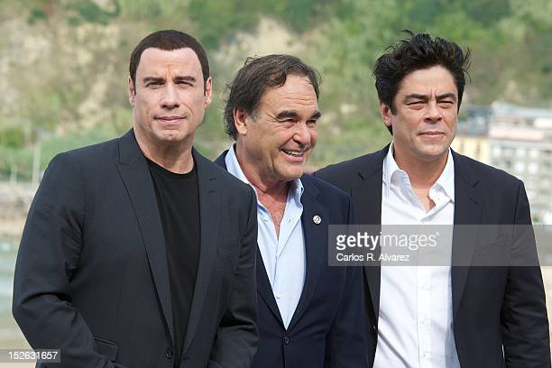 """Director Oliver Stone and actors John Travolta and Benicio del Toro attend the """"Savages"""" photocall at the Kursaal Palace during the 60th San..."""