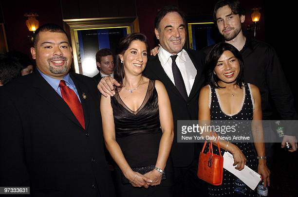 Director Oliver Stone and his girlfriend Chong Son Chong are joined by Port Authority Police Officer William J Jimeno and his wife Allison at the...