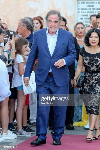 Director Oliver Stone and his wife Sunjung Jung attends the 65th Taormina Film Fest Day 1 on June 30 2019 in Taormina Italy