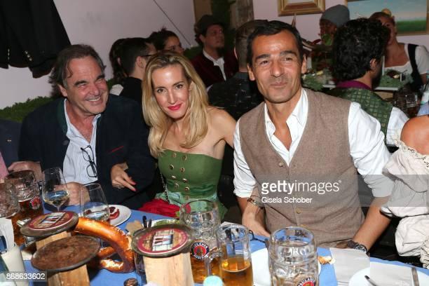 Director Oliver Stone his nice Caroline Goddet and her husband Erol Sander during the Oktoberfest at Kaeferschaenke at Theresienwiese on September 20...