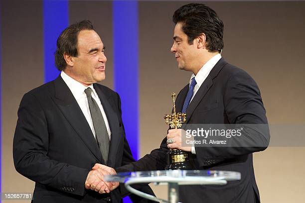 Director Oliver Stone receives from actor Benicio Del Toro the 'Donosti' 60 Anniversary Special Award at the Kursaal Palace during the 60th San...
