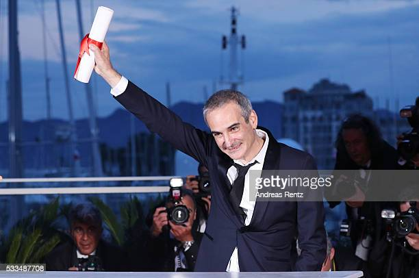 Director Olivier Assayas poses after being awarded the Best Director prize for the movie 'Personal Shopper' during the Palme D'Or Winner Photocall...