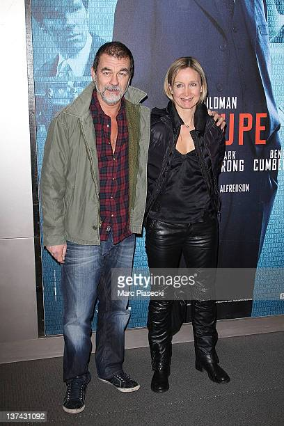 Director Olivier Marchal and his wife Catherine attend the 'Tinker Tailor Soldier Spy' photocall on January 20 2012 in Paris France