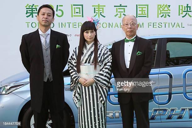 Director Osamu Minorikawa Actress Ko Shibasaki and Producer Shinya Wasaki attend the green carpet of the Tokyo International Film Festival at...