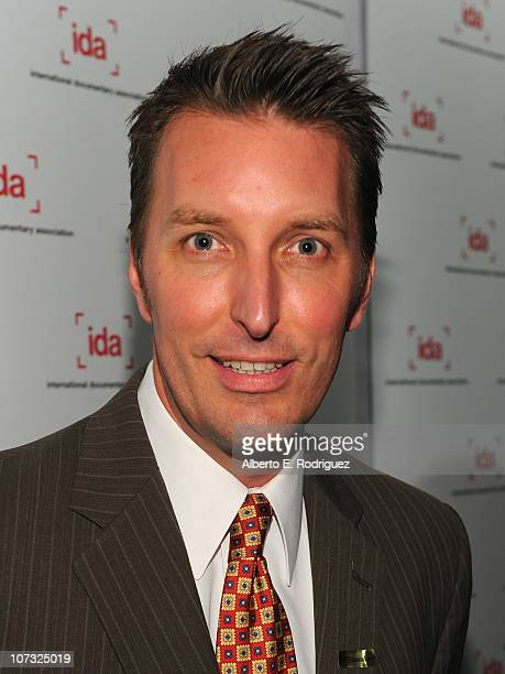 Director Oscar Bucher arrive at the International Documentary Association's 26th annual awards ceremony at the Directors Guild Of America on December...