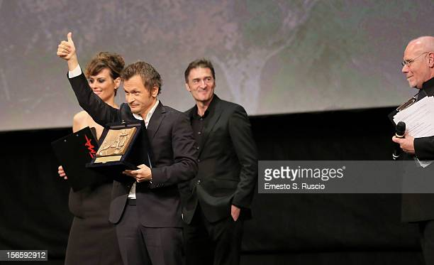 Director Paolo Franchi poses on stage with Best Director Award for the movie 'E la chiamano estate' during the Awards Ceremony at the 7th Rome Film...