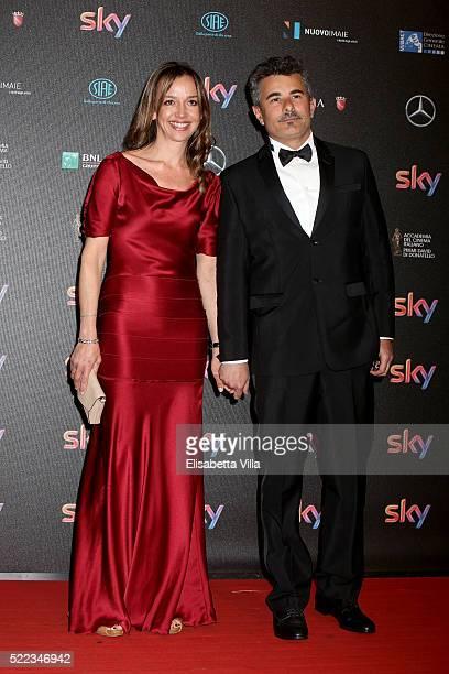 Director Paolo Genovese and Federica Rizzo arrive at the 60 David di Donatello ceremony on April 18 2016 in Rome Italy