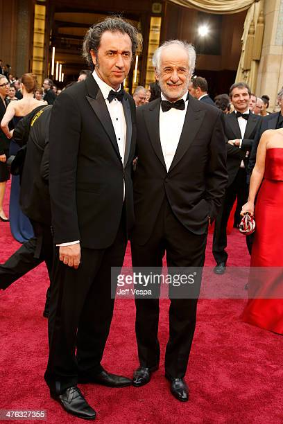 Director Paolo Sorrentino and actor Toni Servillo attend the 86th Oscars held at Hollywood Highland Center on March 2 2014 in Hollywood California