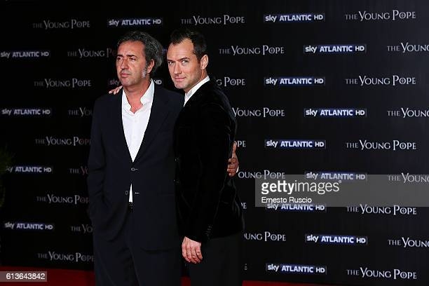 Director Paolo Sorrentino and Jude Law walk the red carpet at 'The Young Pope' premiere at The Space Cinema on October 9 2016 in Rome Italy