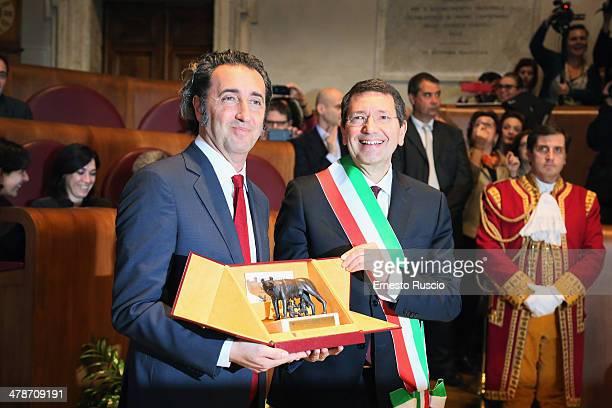 Director Paolo Sorrentino and major Ignazio Marino attend the Honorary Citizenship Of Rome at Campidoglio on March 14 2014 in Rome Italy