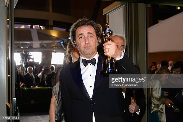 Director Paolo Sorrentino celebrates after winning Best Foreign Language Film for 'The Great Beauty' during the Oscars Governors Ball at Hollywood...