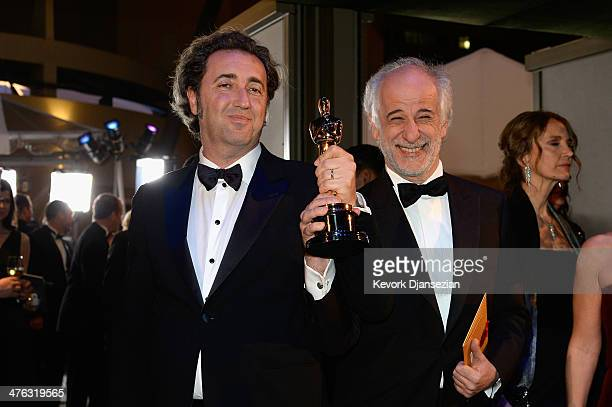 Director Paolo Sorrentino celebrates with Actor Toni after winning Best Foreign Language Film for 'The Great Beauty' during the Oscars Governors Ball...